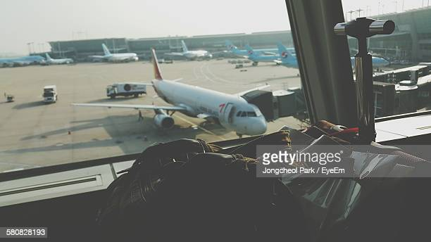 bags by window at incheon international airport - incheon airport stock photos and pictures