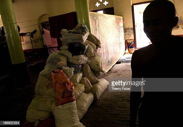 Bags containing material for survivors of the cyclone Nargis donated by people from the Mandalay area are stored in Ma Soe Yein monastery also...