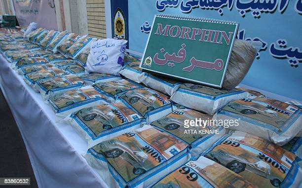 Bags of Afghanmade morphine are displayed during a media tour in the southeastern city of Zahedan on November 29 2008 Drug trafficking is punishable...