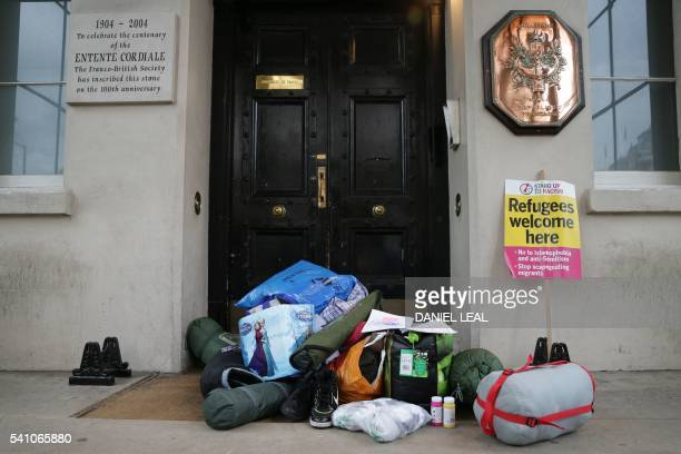 Bags of aid intended for refugees at the camp in Calais are laid on the floor outside the French Embassy in central London on June 18 2016 during a...
