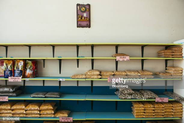 Bags of bird seed sit on half filled shelves for sale in a pet supplies store in Edenville South Africa on Tuesday June 5 2018 More than 60 percent...
