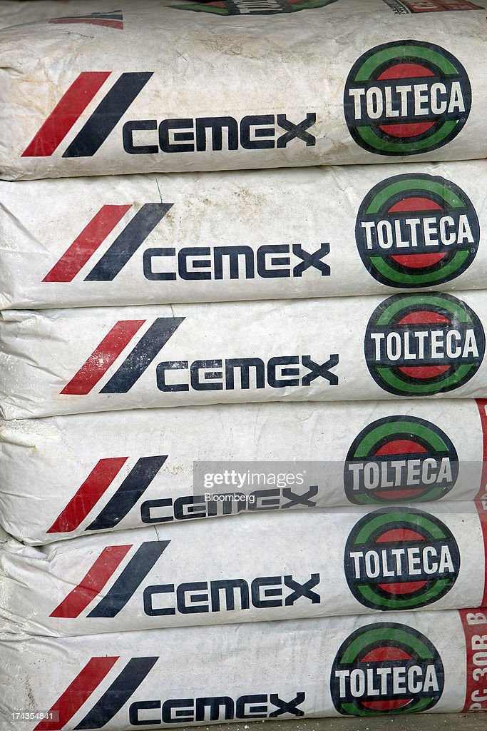 Bags of Cemex SAB's Tolteca brand cement sit stacked at a distribution center in Barrientos in the state of Mexico on Wednesday, July 24, 2013. Mexican President Enrique Pena Nietos $320 billion infrastructure plan is reviving a rally in cement maker Cemex SABs bonds after the emerging-market rout derailed an advance fueled by the U.S. housing rebound. Photographer: Susana Gonzalez/Bloomberg via Getty Images