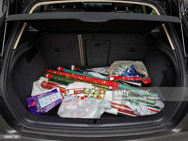 Bags of Christmas paper in trunk of hatchback car