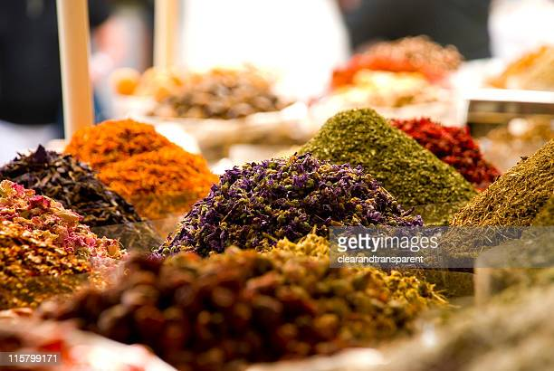 Bags of colorful spices for sale at the Souq