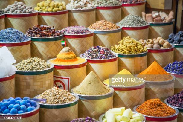 bags of colorful spices for sale at the souq - stock photo - wang he stock pictures, royalty-free photos & images