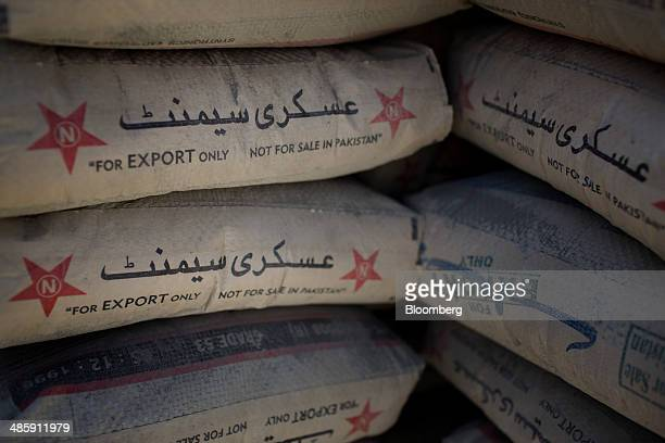 "Bags of concrete used for building blast walls are are marked with ""For Export Only, Not For Sale in Pakistan"" at a facility north of Kabul,..."
