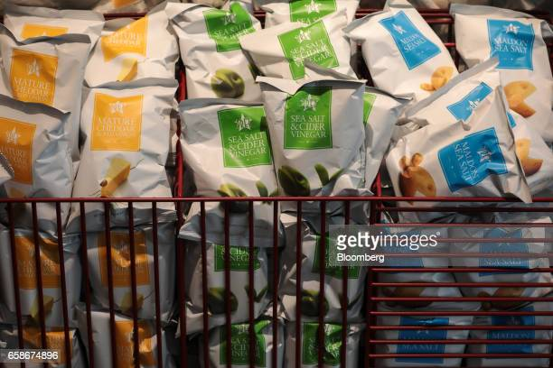 Bags of crisps sit in baskets inside a branch of food retailer Pret a Manger Ltd in London UK on Monday March 27 2017 Food chain Pret a Manger said...