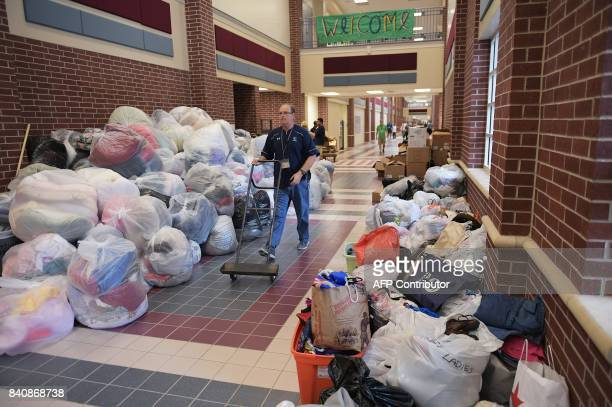 Bags of donated clothing and linen are seen in College Park High School which was set up as a temporary shelter for Hurricane Harvey evacuaees in The...