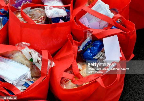 Bags of food to be distributed during a food distribution by the Olivet Boys and Girls Club, Heidelberg Family Restaurant, and Clover Dairy Farms,...