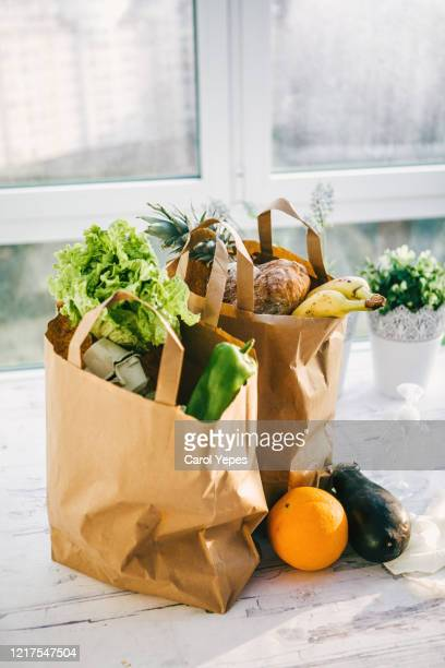 bags of fruit and vegetables delivered at home - bag stock pictures, royalty-free photos & images