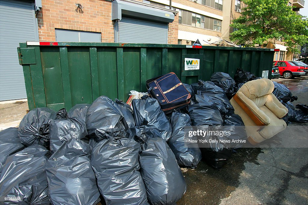Bags Of Garbage Are Piled Next To A Dumpster On Park Ave In News
