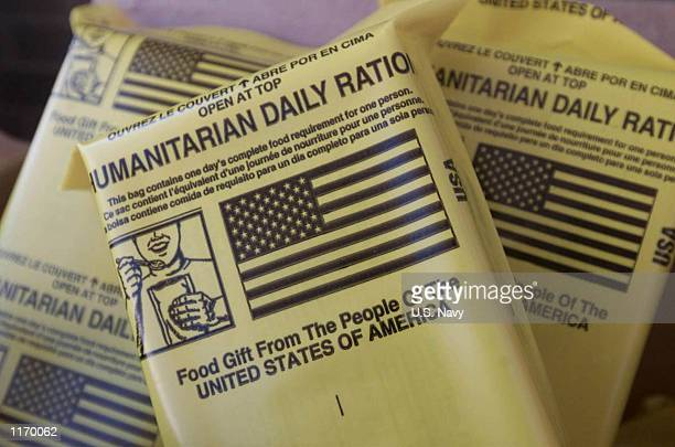 Bags of Humanitarian Daily Rations are dropped after air attacks by C17 Globemaster III aircrews October 3 2001 into povertystricken areas of...
