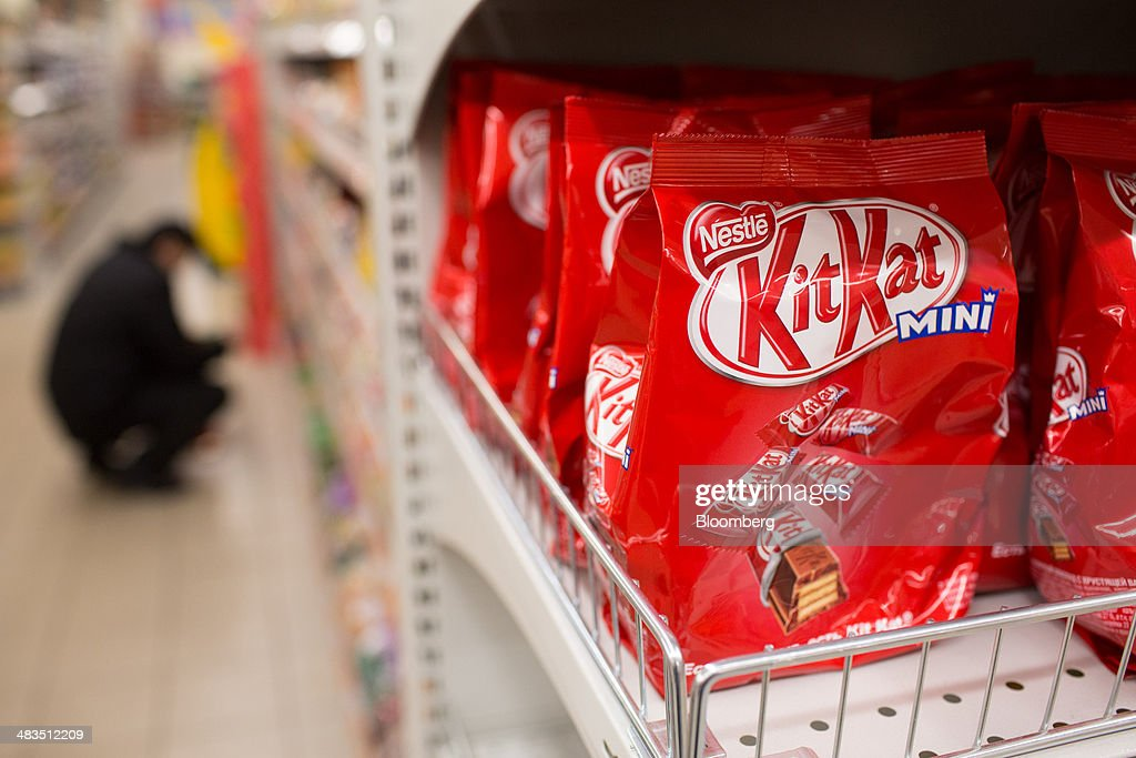 Bags of mini KitKat confectionary, produced by Nestle SA, sit for sale inside a Dixy supermarket operated by OAO Dixy Group in Moscow, Russia, on Tuesday, April 8, 2014. Suppliers suffering from ruble depreciation this quarter are urging retailers to increase prices. Photographer: Andrey Rudakov/Bloomberg via Getty Images
