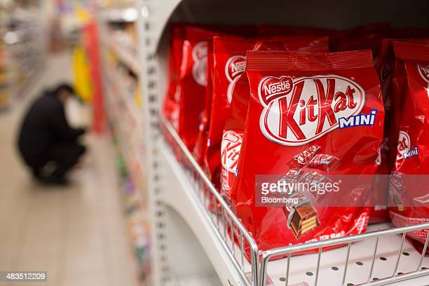 Bags of mini KitKat confectionary produced by Nestle SA sit for sale inside a Dixy supermarket operated by OAO Dixy Group in Moscow Russia on Tuesday...