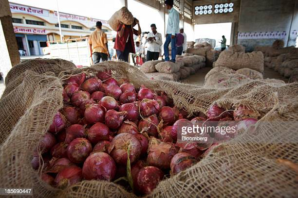 Bags of onions sit at a wholesale market in Nashik Maharashtra India on Wednesday Oct 23 2013 Onion prices in India may extend a record rally as...