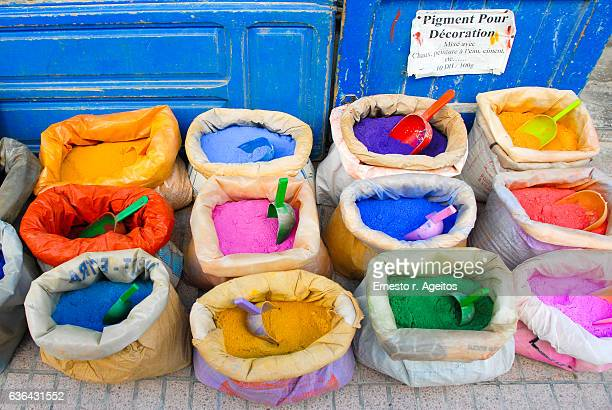 Bags of powdered color pigments at Essaouira market, Morocco