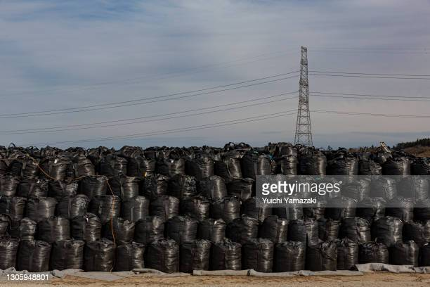"""Bags of radiation contaminated soil are gathered inside the """"difficult-to-return"""" zone on March 08, 2021 in Namie, Japan. In ceremonies that are..."""