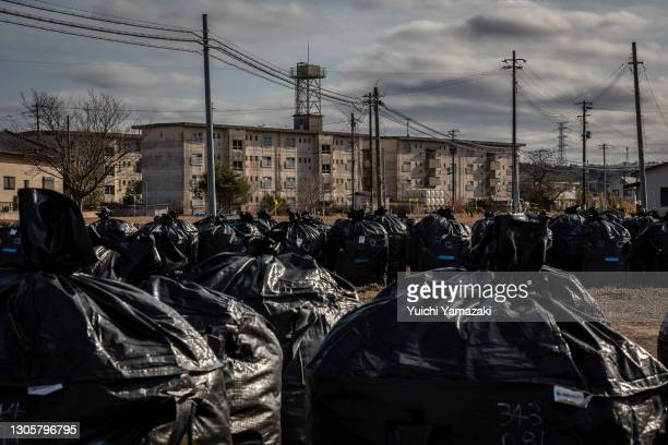 Bags of radiation contaminated soil are gathered on March 7, 2021 in Futaba, Japan. In ceremonies that are expected to be scaled back because of the...