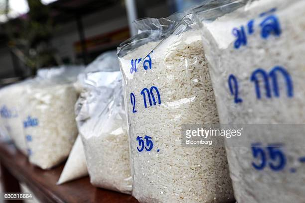 Bags of rice are displayed for sale at farmer Suphatson Chanthamon's stall in a PTT Pcl gas station in Ubon Ratchathani Thailand on Wednesday Nov 9...