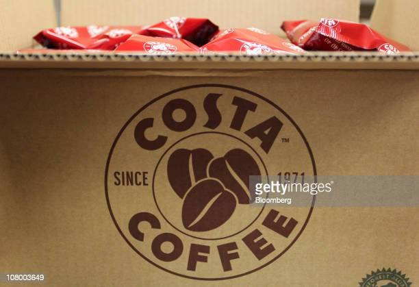 Bags of roasted coffee beans sit in a box at the Costa Coffee central storage facility in London UK on Wednesday Jan 12 2011 Whitbread Plc may be...