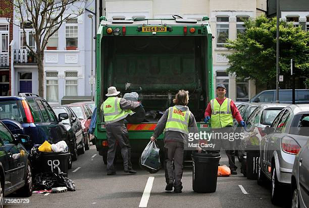 Bags of rubbish are collected on a domestic street in Clapham on April 26 2007 in London Many councils in the UK are considering introducting rubbish...