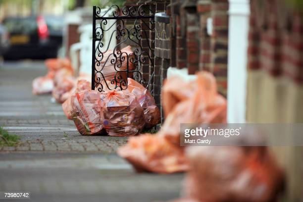 Bags of rubbish await collection on a domestic street in Clapham on April 26 2007 in London Many councils in the UK are considering introducting...
