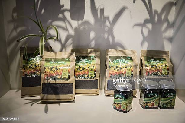 Bags of solid fertilizer made from pig excrement sit on display in a visitor center at the Jia Hua antibiotic-free pig farm in Tongxiang, China, on...