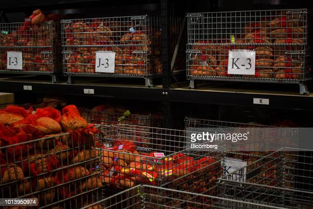 Bags of soybeans sit in metal crates at the Bay Farm Research Facility in Columbia Missouri US on Thursday July 19 2018 Grainpriceshave been...