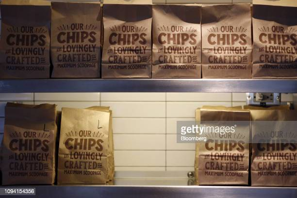 Bags of tortilla chips sit on display at a Chipotle Mexican Grill Inc restaurant in Louisville Kentucky US on Saturday Feb 2 2019 Chipotle Mexican...