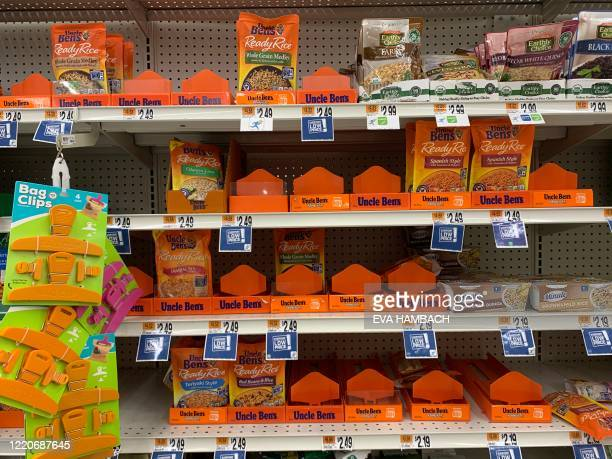 Bags of Uncle Ben's rice are seen on a store shelf on June 17 2020 in WashingtonDC Amid nationwide protests against racism major US food companies on...