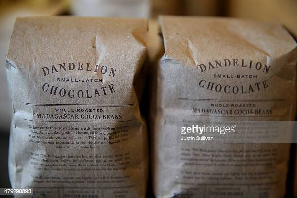 Bags of whole roasted cocoa beans are displayed at Dandelion Chocolate on March 17 2014 in San Francisco California A new study sponsored by the...