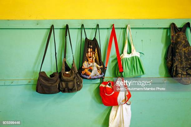 Bags of workers hang in a row at the Despalillo factory in the Western province of Pinar del Rio in San Juan y Martinez on February 27 2018 Cuba...