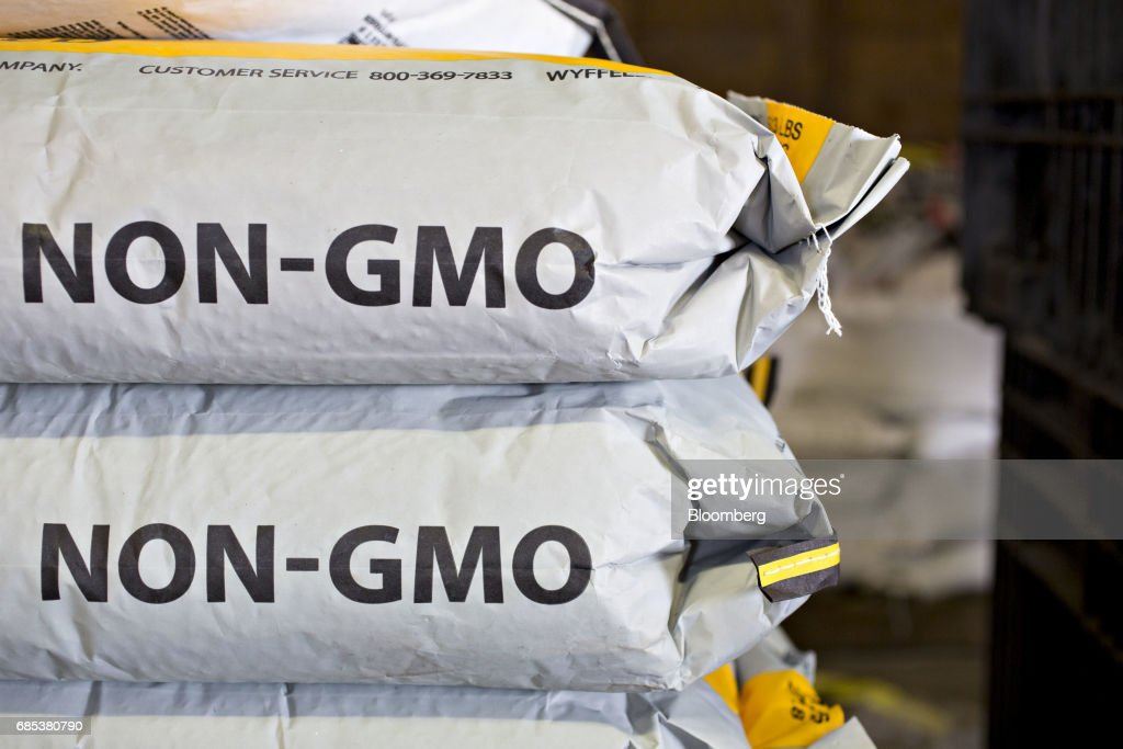 Bags of Wyffels Hybrids Inc. non-GMO corn seed are arranged for a photograph in Malden, Illinois, U.S., on Wednesday, May 17, 2017. Rain in the Midwest and Great Plains will slow corn, soybean and wheat planting progress as well as curb seed germination and early growth, according to a senior meteorologist at the MDA Weather Services. Photographer: Daniel Acker/Bloomberg via Getty Images