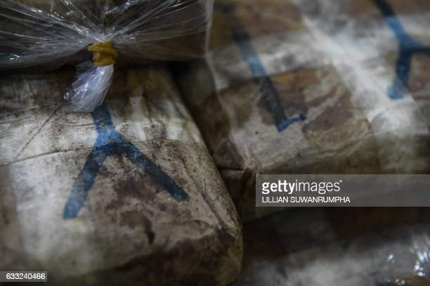 Bags of 'yaba' tablets or methamphetamine mixed with caffeine are displayed for the media in front of the Narcotics Suppression Division in Bangkok...