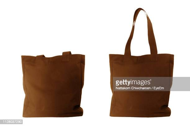bags on white background - tote bag stock pictures, royalty-free photos & images