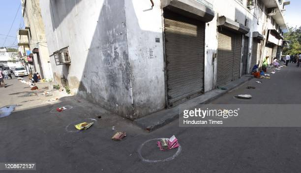 Bags seen placed at circles marked for proper adherence of social distancing as a precautionary measure outside a FPS ration shop , on day 6 of the...