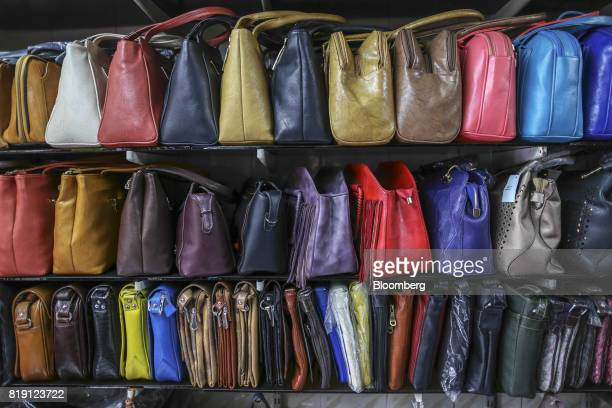 Bags sit on display at the Shakra Leather Arts store in the Dharavi area of Mumbai India on Tuesday July 18 2017 India's new goods and services tax...