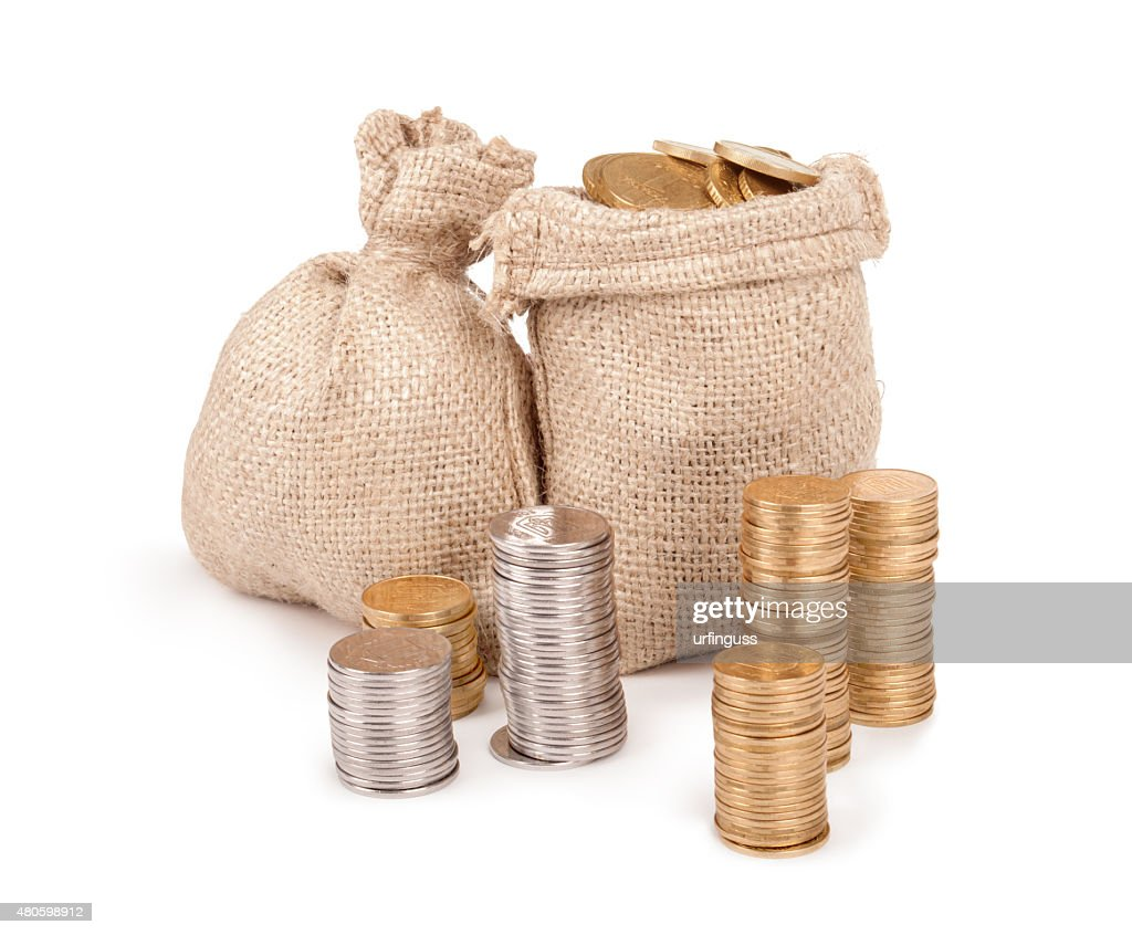 bags with coins isolated on white background : Stock Photo