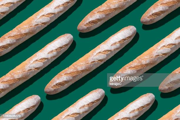 baguette long loaf arrangement pattern - french culture stock pictures, royalty-free photos & images