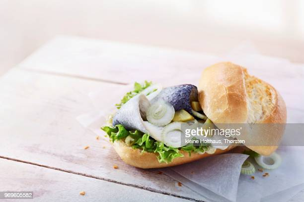 Baguette with Bismarck herring, gherkins, lettuce and onions