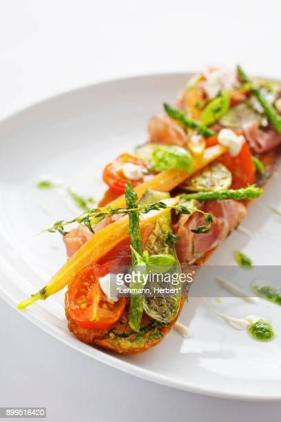 baguette with ham, grilled vegetables and pesto - ピストー ストックフォトと画像