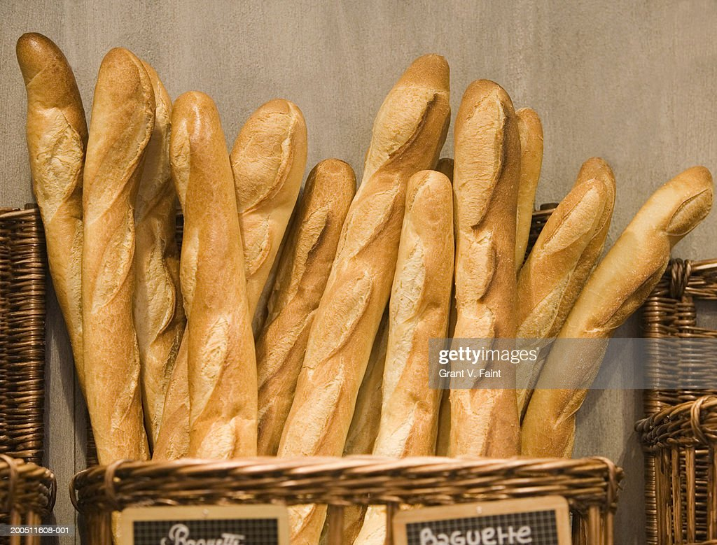 Baguettes in basket in bakery : Stock Photo