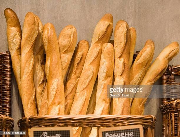 Baguettes in basket in bakery