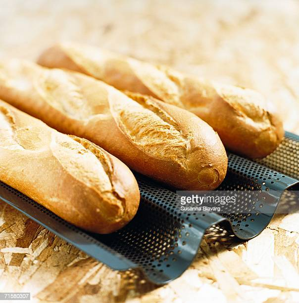 Baguettes on a baking tray close-up.