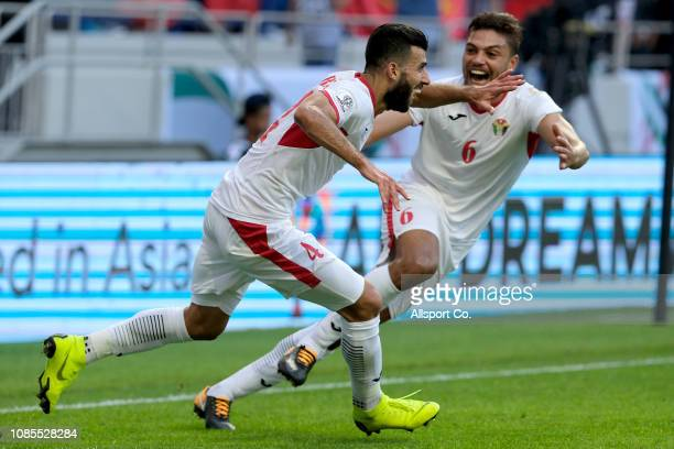 Baha Abdelrahman#4 clebrates with Saeed Hasan#6 after scoring their ast goal against Vietnam during the AFC Asian Cup round of 16 match between...
