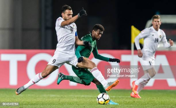 Baha' Faisal of Jordan fights for the ball with Abdullah Al Khaibari of Saudi Arabia during the AFC U23 Championship China 2018 Group C match between...