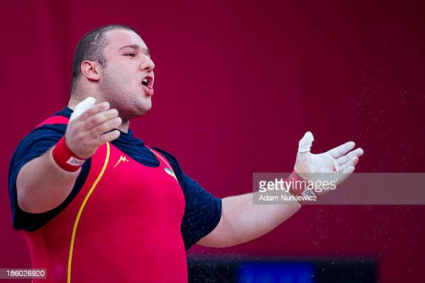 Bahador Moulaei from Iran reacts after his lift in the Snatch competition men's 105 kg Group A during weightlifting IWF World Championships Wroclaw...