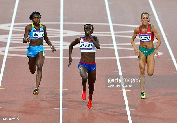 Bahamas' Anthonique Strachan France's Myriam Soumare and Bulgaria's Ivet Lalova compete in the women's 200m semifinals at the athletics event during...
