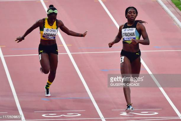 Bahamas' Anthonique Strachan leads Jamaica's Shashalee Forbes as she cross the finsh line in the Women's 200m heats at the 2019 IAAF Athletics World...