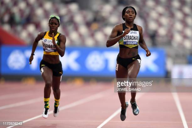 Bahamas' Anthonique Strachan leads Jamaica's Shashalee Forbes in the Women's 200m heats at the 2019 IAAF Athletics World Championships at the Khalifa...